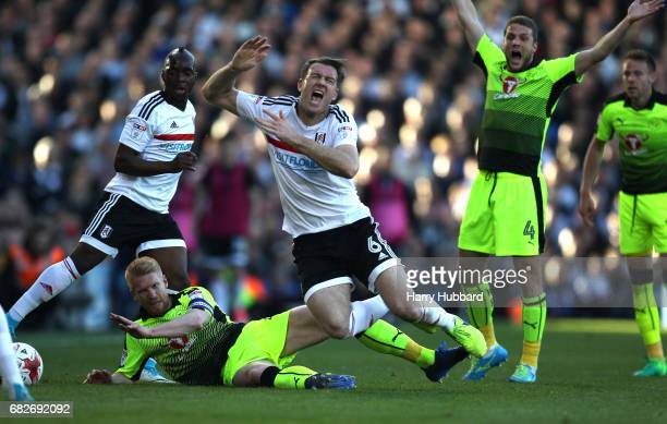 George Evans of Readireacts tackles Tom Cairney of Fulham during the Sky Bet Championship Play off semi final 1st leg match between Fulham and...