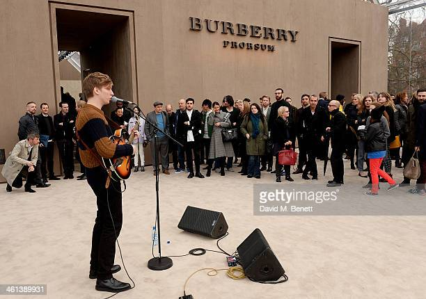 George Ezra performs at the AW14 Menswear Show after show at Kensington Gardens on January 8 2014 in London England