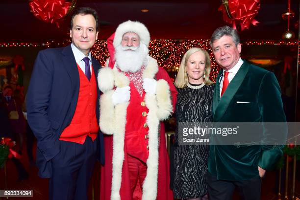 George Farias Santa Claus Anne Hearst McInerney and Jay McInerney attend A Christmas Cheer Holiday Party 2017 Hosted by George Farias and Anne and...