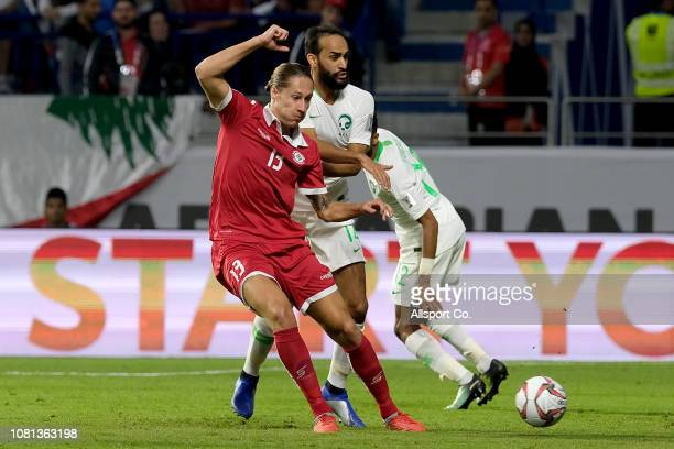 George Felix of Lebanon holds off Abdullah Otayf of Saudi Arabia during the AFC Asian Cup Group E match between Lebanon and Saudi Arabia at Al...