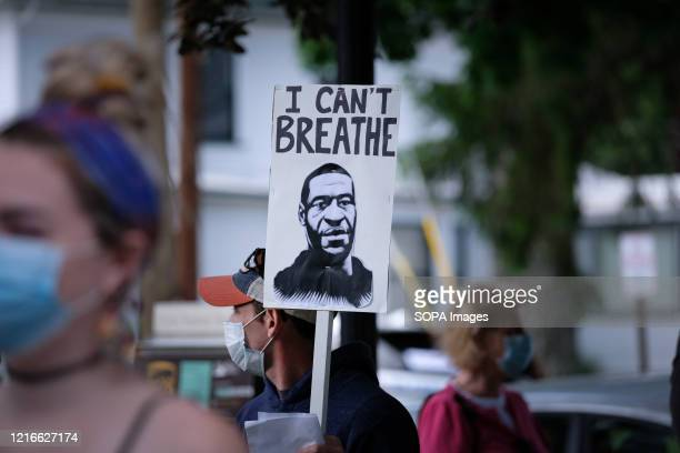 George Floyd I can't breath placard during a vigil for George Floyd held in Pennsylvania White police officer Derek Chauvin knelt on George Floyd's...