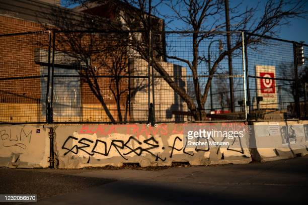 "George Floyd"" is written on a barricade outside the Third Police Precinct on April 1, 2021 in Minneapolis, Minnesota. The Derek Chauvin murder trial..."