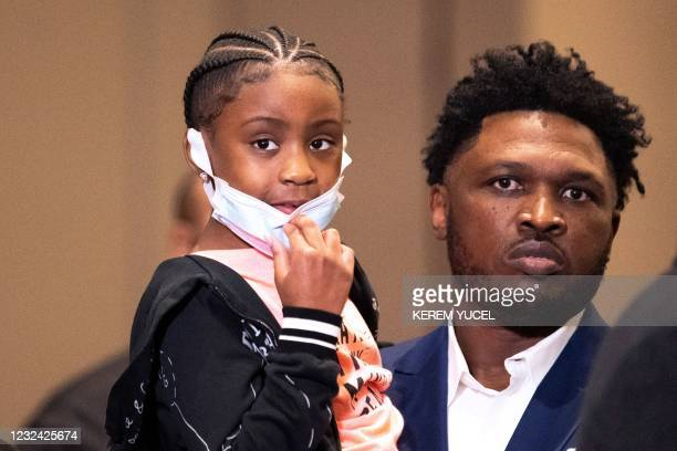 George Floyd's 6-year-old daughter Gianna Floyd looks on during a press conference following the verdict in the trial of former police officer Derek...
