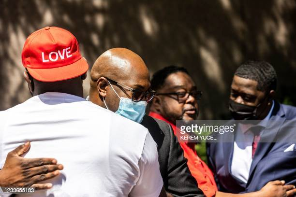 George Floyd's brother Philonise Floyd hugs an activist following the sentencing of former Minneapolis police officer Derek Chauvin, outside the...