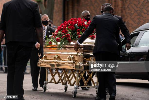 George Floyd's casket is wheeled to a hearse after a memorial service at North Central University on June 4 2020 in Minneapolis Minnesota Rev Al...