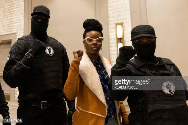 George Floyd's cousin's daughter Tedra McGee poses with members of The Original Black Panthers of Minnesota after a press conference following the...