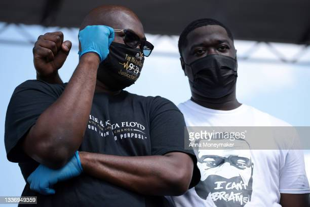"""George Floyd's nephew Brandon Williams, and brother Philonise Floyd listen onstage at the """"March On for Washington and Voting Rights"""" event on the..."""