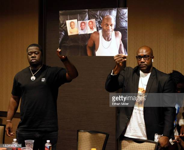 George Floyd's nephew Brandon Williams and brother Philonise Floyd hold up a photo of Byron Williams during a news conference at the Golden Nugget...