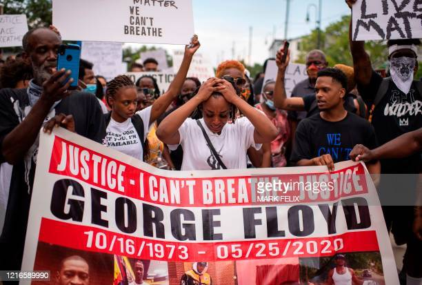"George Floyds niece Gabrielle Thompson reacts during a ""Justice for George Floyd"" event in Houston, Texas on May 30 after George Floyd, an unarmed..."