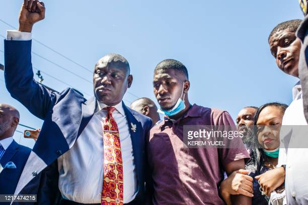 TOPSHOT George Floyd's son Quincy Mason Floyd and family Attorney Ben Crump and other family members visit on June 3 the site where George Floyd died...