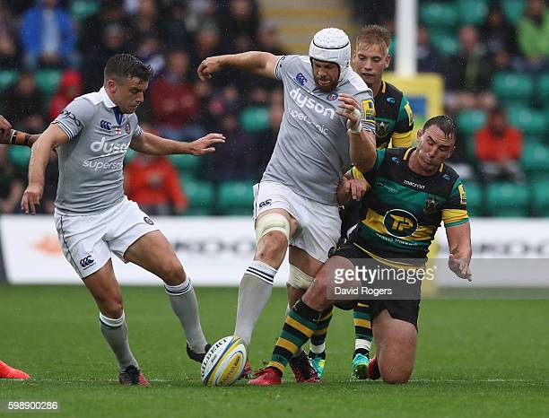 George Ford and Dave Attwod of Bath combine to clear the ball from Louis Picamoles during the Aviva Premiership match between Northampton Saints and...
