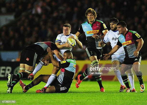 George Ford of Bath Rugby is tackled by Chris Robshaw and Darryl Marfo of Harlequins during the Aviva Premiership match between Harlequins and Bath...