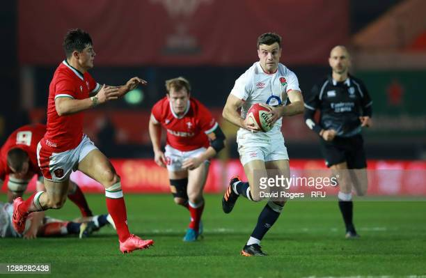 George Ford of England breaks away from Louis Rees-Zammit of Wales during the Autumn Nations Cup match between Wales and England at Parc y Scarlets...