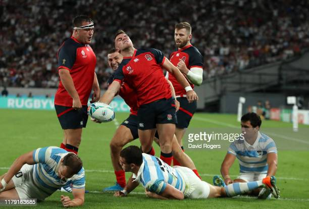 George Ford of England celebrates after scoring a try during the Rugby World Cup 2019 Group C game between England and Argentina at Tokyo Stadium on...