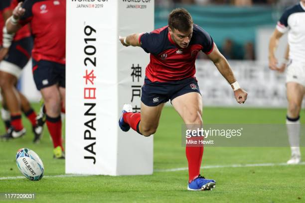 George Ford of England celebrates after touching down to score his team's first try during the Rugby World Cup 2019 Group C game between England and...