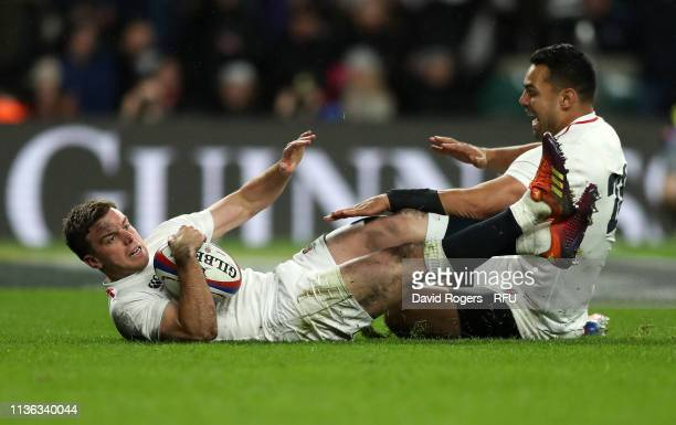 George Ford of England celebrates with team mate Ben Te'o after scoring their last minute match saving try during the Guinness Six Nations match...