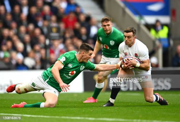 George Ford of England goes past Johnny Sexton of Ireland to score his team's first try during the 2020 Guinness Six Nations match between England...
