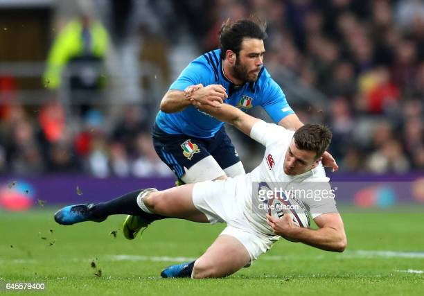 George Ford of England is challenged by Luke McLean of Italy during the RBS Six Nations match between England and Italy at Twickenham Stadium on...