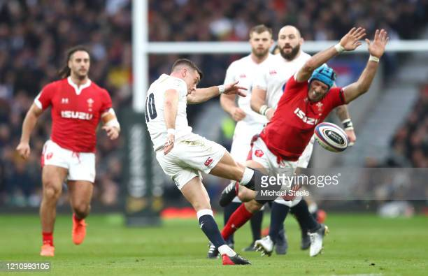 George Ford of England kicks up field with Rhys Carre of Wales attempting the charge down during the 2020 Guinness Six Nations match between England...