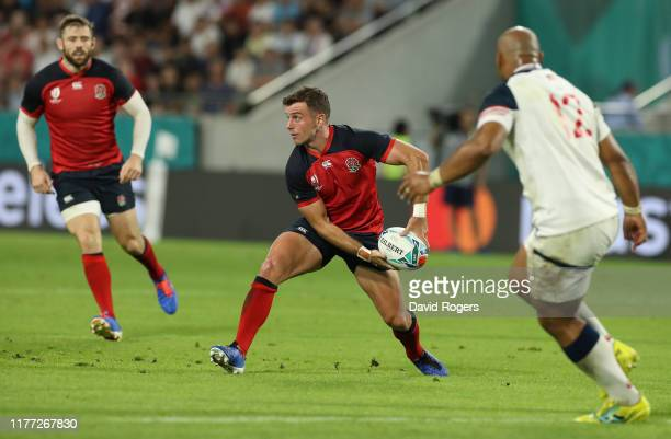 George Ford of England passes the ball as Paul Lasike looks on during the Rugby World Cup 2019 Group C game between England and USA at Kobe Misaki...