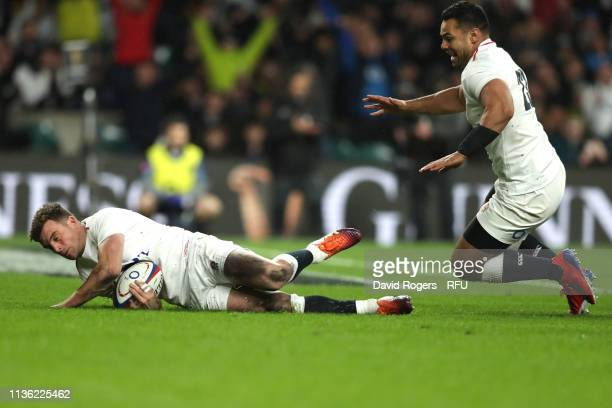 George Ford of England touches as he scores their sixth try as Ben Te'o celebrates during the Guinness Six Nations match between England and Scotland...