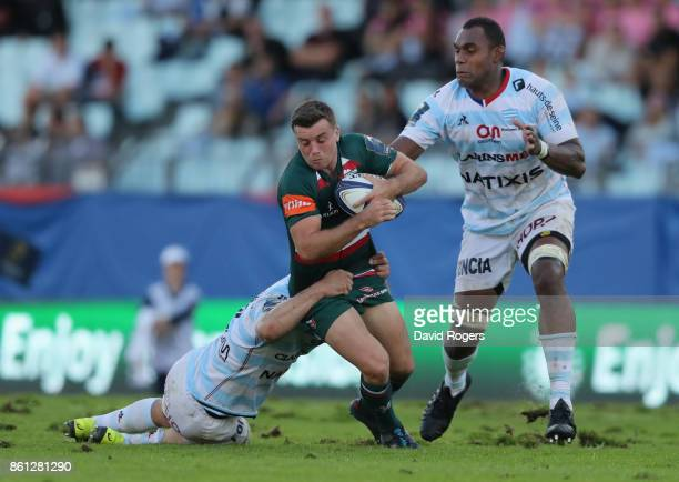 George Ford of Leicester is tackled by Henry Chavancy and Leone Nakarawa during the European Rugby Champions Cup match between Racing 92 and...