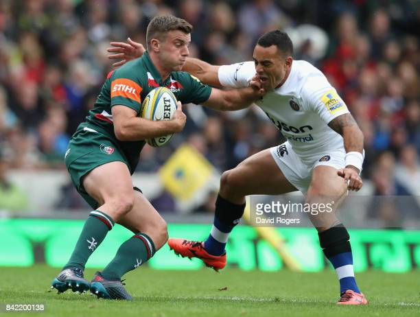 George Ford of Leicester is tackled by Kahn Fotuali'i during the Aviva Premiership match between Leicester Tigers and Bath Rugby at Welford Road on...