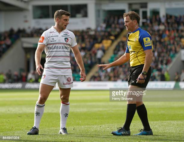 George Ford of Leicester Tigers and referee JP Doyle during the Aviva Premiership match between Northampton Saints and Leicester Tigers at Franklin's...