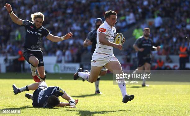 George Ford of Leicester Tigers breaks clear of the Sale defence to score a try during the Aviva Premiership match between Sale Sharks and Leicester...
