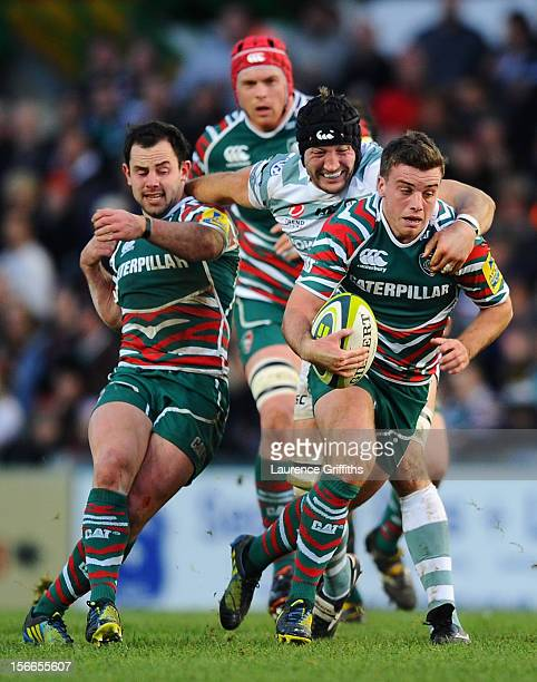 George Ford of Leicester Tigers is tackled by George Skivington of London Irish during the LV= Cup match between Leicester Tigers and London Irish at...