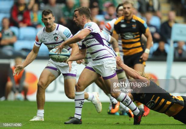 George Ford of Leicester Tigers makes a break to set up a try for team mate Jonny May during the Gallagher Premiership Rugby match between Wasps and...
