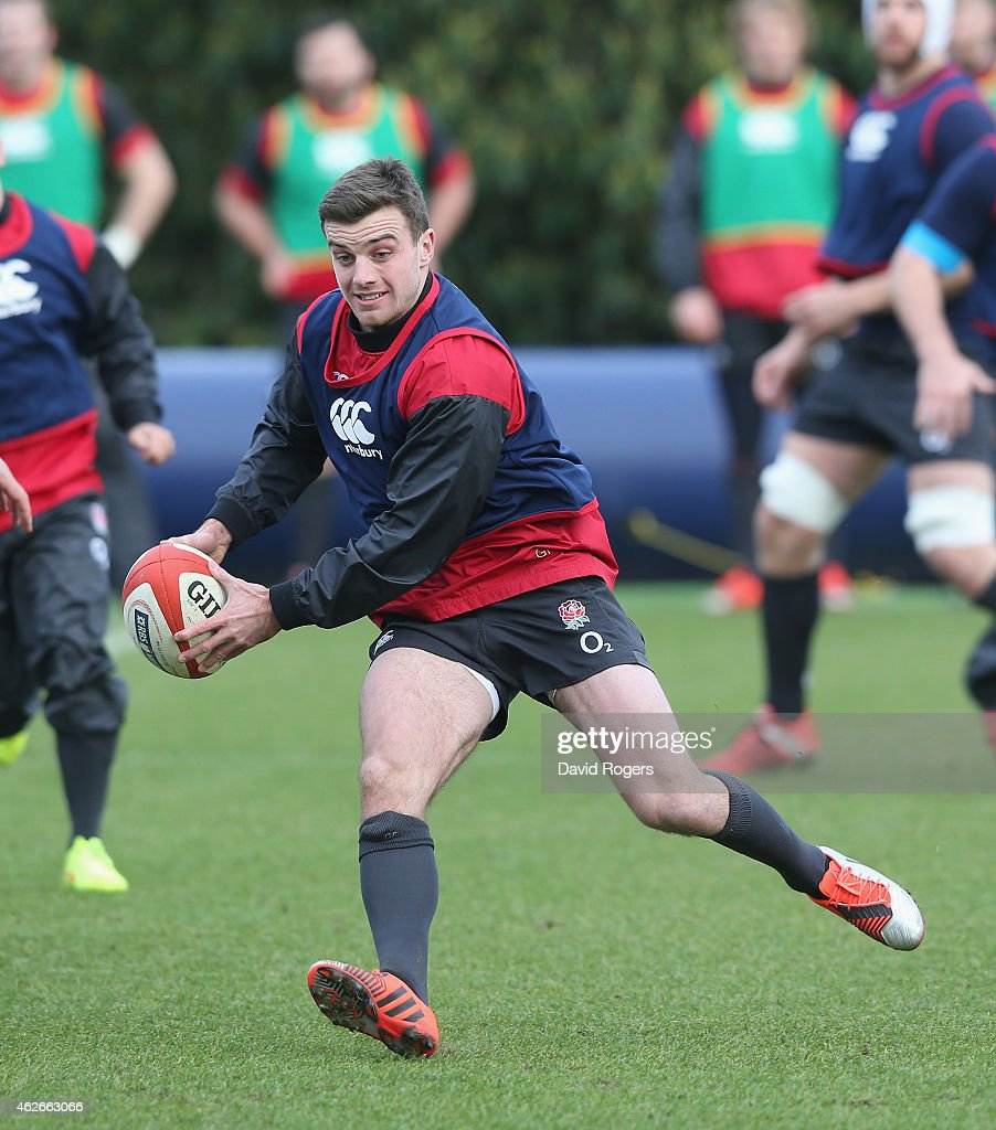 George Ford runs with the bal during the England training session held at Pennyhill Park on February 2, 2015 in Bagshot, England.