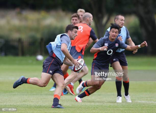 George Ford runs with the ball during the England training session at the Lensbury Club on August 7 2017 in Teddington England