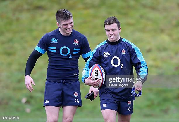 George Ford talks to team mate Owen Farrell during the England training session held at Pennyhill Park on February 20 2014 in Bagshot England