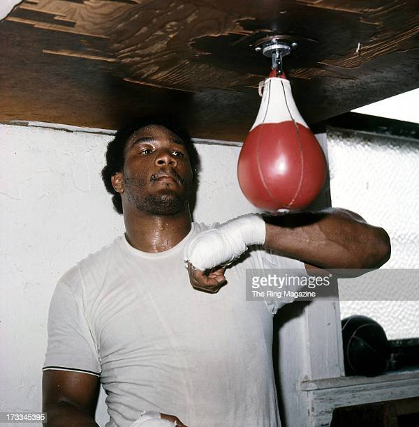 George Foreman hits the speed bag as he trains in a Los Angeles gym