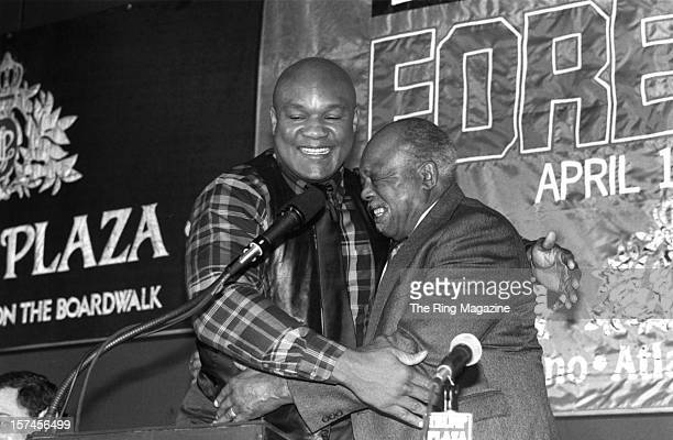 George Foreman hugs Archie Moore during a press conference for his upcoming fight
