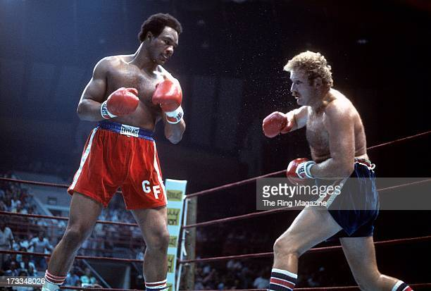 George Foreman looks to throw a punch against Scott LeDoux during the fight at the Utica Memorial Auditorium in Utica, New York. George Foreman won...