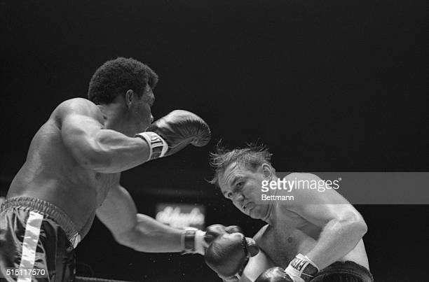 George Foreman makes a long left jab at Chuck Wepner in the second round of their fight, August 18th. Wepner's eye opened up slightly in the first,...