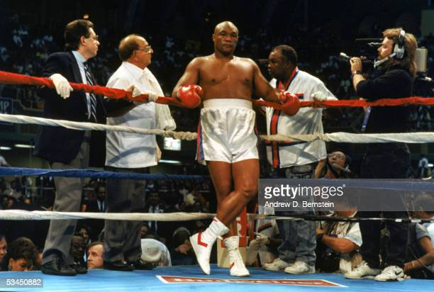 George Foreman stands in his corner of the ring between his trainer Angelo Dundee and cornerman Drew Bundini Brown as he prepares to fight Evander...