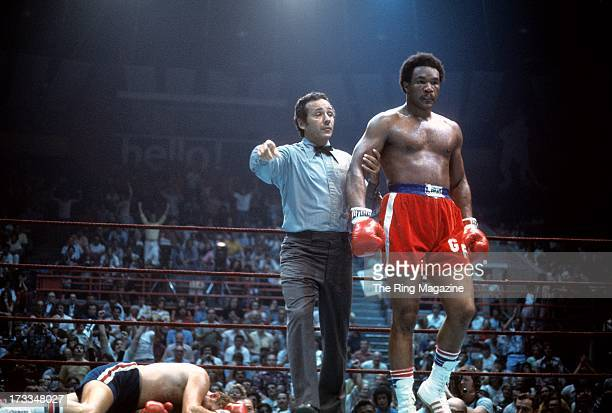 George Foreman walks to his corner after knocking out Scott LeDoux during the fight at the Utica Memorial Auditorium in Utica, New York. George...