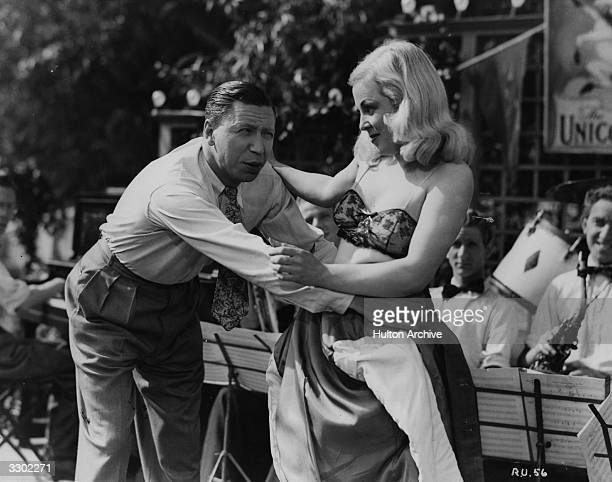 George Formby and Daphne Elphinstone star in the Columbia film 'George In Civvy Street' a mild comedy directed by Marcel Varnel