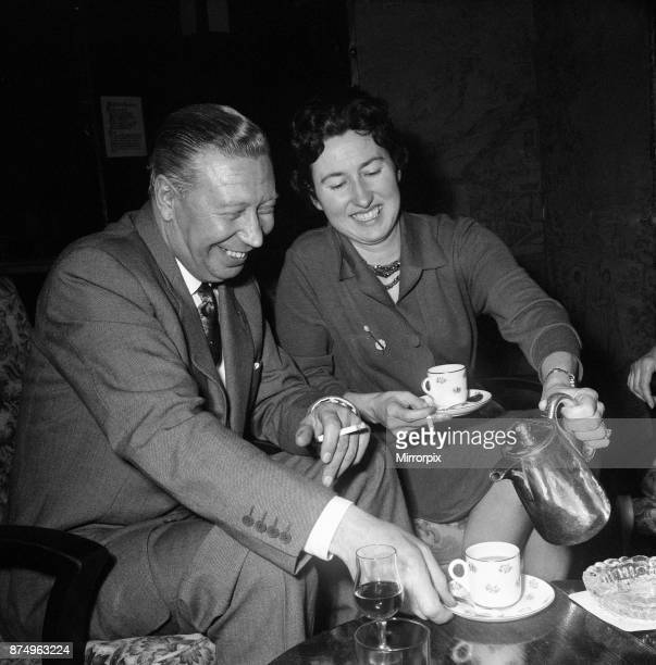 George Formby and fiancee Pat Howsen of Preston She is wearing the huge solitaire diamond ring on her engagement finger George is wearing his usual...
