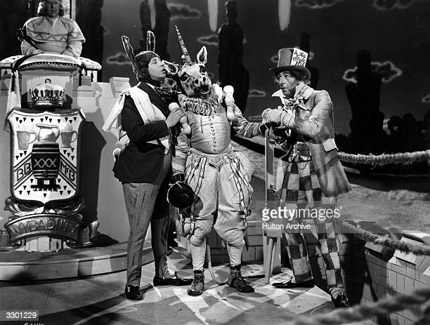 George Formby and Ronald Shiner in a surreal scene from the Columbia comedy 'George In Civvy Street' echoing 'Alice in Wonderland' The film was...