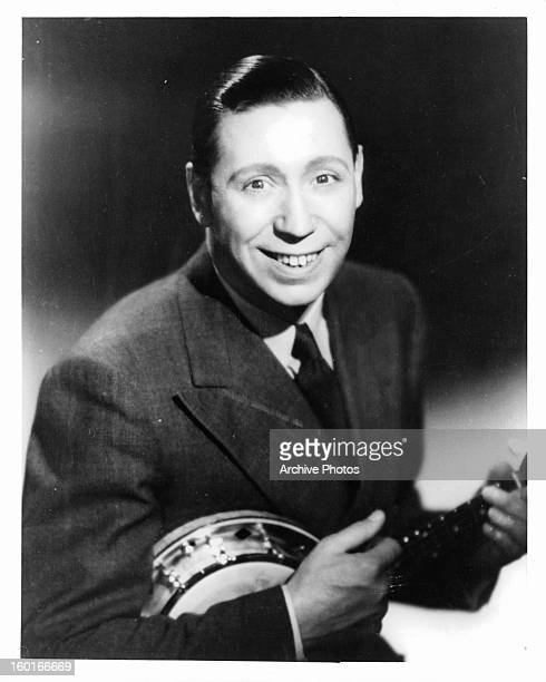 George Formby plays banjo in publicity portrait for the film 'Keep Fit' 1937