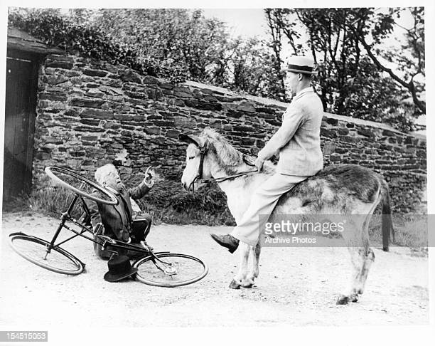George Formby riding mule in a scene from the film 'No Limit' 1935