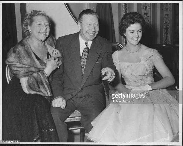 George Formby the ukulelepalying English comedian and film actor attends the first night of Romance in Candlelight with his wife Beryl and Georgie...