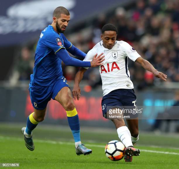 George Francomb of AFC Wimbledon and Kyle WalkerPeters of Tottenham Hotspur battle for the ball during The Emirates FA Cup Third Round match between...