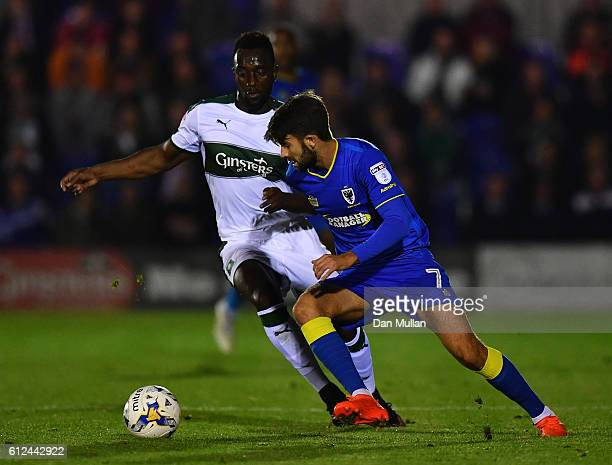 George Francomb of AFC Wimbledon holds off Jordan Slew of Plymouth Argyle during the EFL Checkatrade Trophy match between AFC Wimbledon and Plymouth...