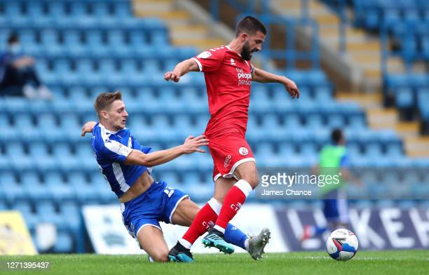 George Francomb of Crawley Town is challenged by Henry Woods of Gillingham FC during the EFL Trophy match between Gillingham and Crawley Town at...