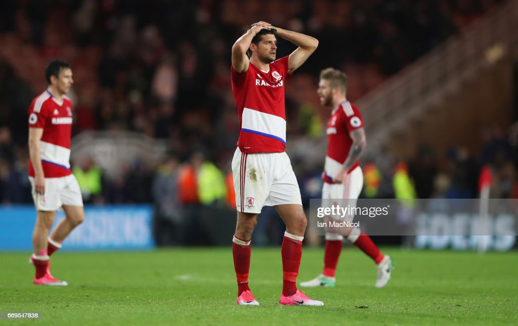 George Friend of Middlesbrough (C) and team mates look dejected in defeat after during the Premier League match between Middlesbrough and Arsenal at Riverside Stadium on April 17, 2017 in Middlesbrough, England.
